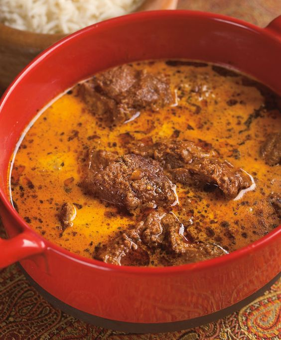 "Lamb is stewed tender in a luscious curry of green cardamom and buttermilk in this recipe from ""Vij's At Home: Relax, Honey""."