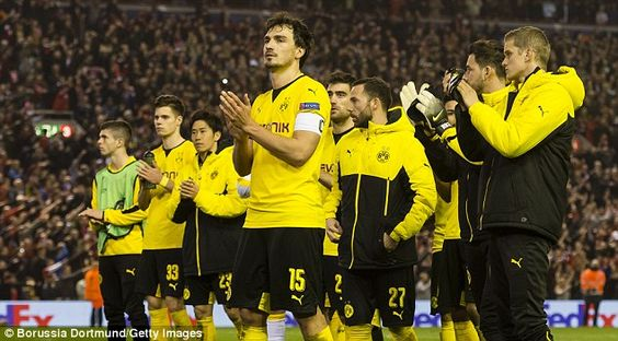The Dortmund players go over and applaud their travelling fans at the full-time whistle