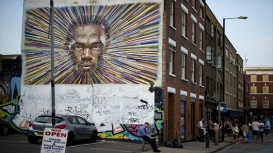 Street artists take satirical aim at Olympics