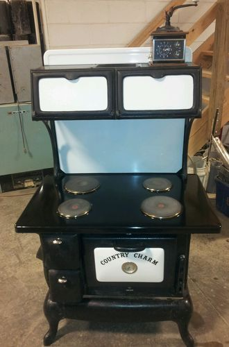 Country Charm Cast Iron Electric Stove | I just got one like this for my cabin.