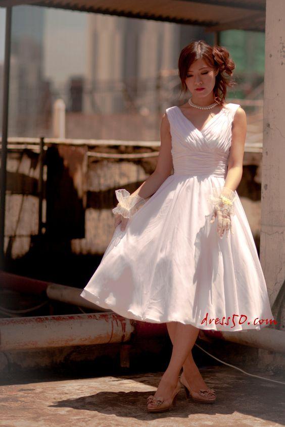Ready to ship Sample--  50's inspired Vneckline  chiffon  tea length wedding dress. $180,00, via Etsy.