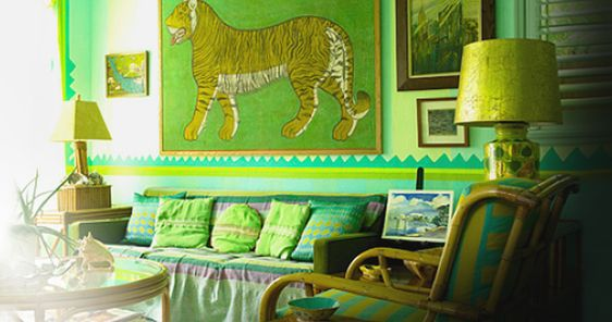 Doug & Gene Meyer, Miami, Florida Particularly known for their commanding sense of color and profound creativity, the New York-based Meyer brothers run a thriving design business that includes interiors, furniture, housewares and fashion. Here, in the Miami home Gene shares with his partner, interior designer Frank di Biasi, one of the brothers' graphic, color-blocked rugs for Holland & Sherry enlivens a retro-feeling, Tiki-tinged room whose verdant hues might leave some green with envy.: