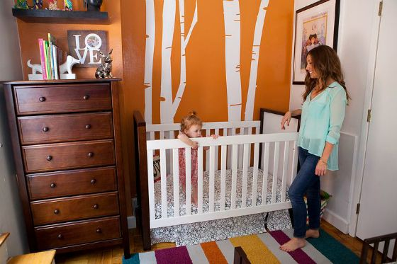 Shared Small Space Nursery and Toddler Room - love the orange accent wall!