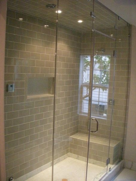Single niche in the middle glass doors tile on 3 walls for Steam shower bathroom ideas