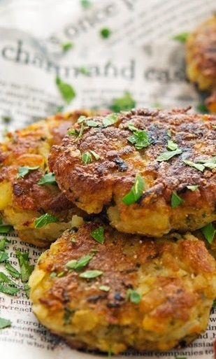 ALOO TIKKI (spiced potato patty) ~~~ recipe gateway: this post's link throws in a bit of untraditional by serving the patties with sriracha ketchup instead of tomato chutney AND http://www.vegrecipesofindia.com/aloo-tikki-aloo-pattice-recipe-made-from-leftover-potatoes/ [India, Regional North] [Jamie Oliver] [theironyou] [vegrecipesofindia]
