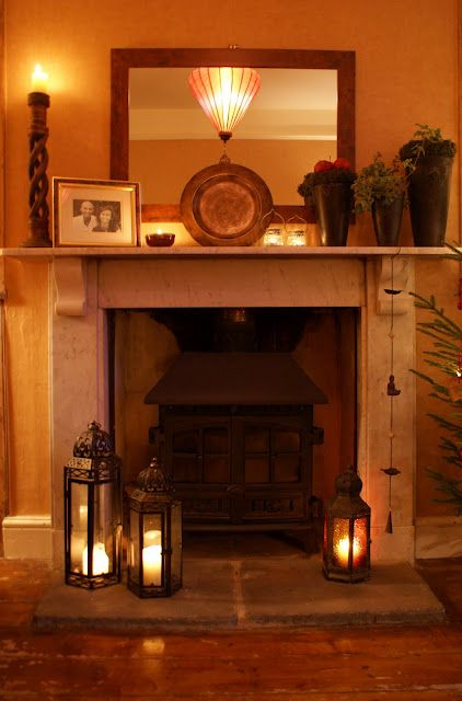 love the lanterns by the fireplace