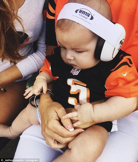 Cutest fan: Katherine Webb's son Tripp wore a mini version of his dad AJ McCarron's football jersey to the Cincinnati Bengals pre-season game against the Indianapolis Colts on Thursday