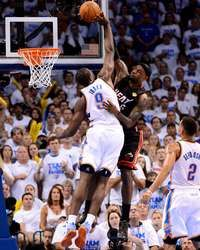 LeBron James of the Miami Heat goes up for a dunk against Serge Ibaka of the Oklahoma City Thunder, #OKCThunder #NBAFinals http://www.fansedge.com/LeBron-James-Serge-Ibaka-Miami-Heat-Oklahoma-City-Thunder-NBA-Finals-Game-2-6142014-_745357898_PD.html?social=pinterest_pfid77-20184