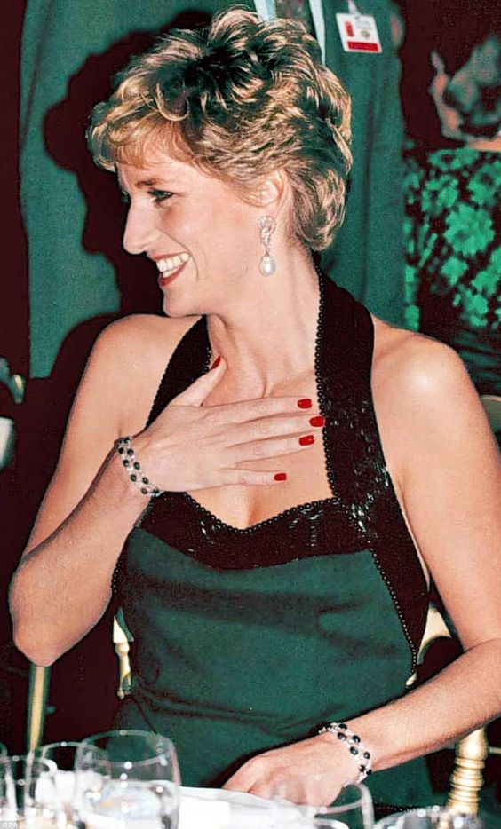 Diana made these two bracelets from a tassel necklace containing alternating square-cut diamonds and sapphires. She debuted the bracelets at a concert at Versailles in 1994