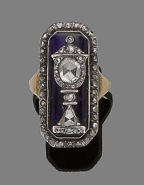 A blue glass and diamond mourning ring, circa 1800  The rectangular blue glass plaque applied with a central rose-cut diamond urn motif, within a border of similarly-cut diamonds, in closed-back settings, mounted in silver and gold, hoop probably later