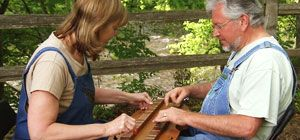 At their small shop in Townsend, Tennessee, Mike and Connie construct dulcimers and encourage dulcimer musicians with outdoor concerts on their property.