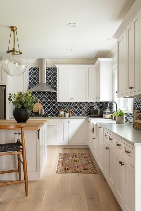 Well Appointed Black And White Kitchen Features A Pink And Blue