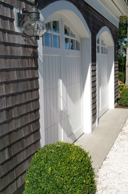 White Garagedoor With Both Sided Flanking Lighting Lamps