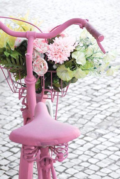 Pink peonies on a pink bicycle.