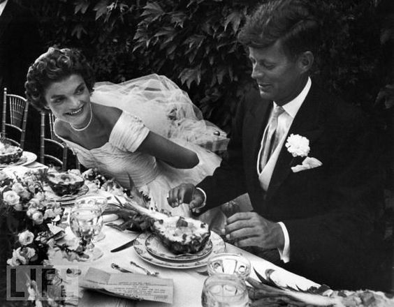 Senator John F. Kennedy and socialite Jacqueline Bouvier celebrate their 1953 nuptials with a reception at her stepfather's estate in Newport, Rhode Island.