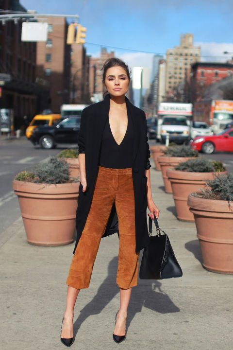 Olivia Culpo steps out during New York Fashion Week wearing a black bodysuit, jacket and suede culottes all from Express. Shop the affordable look, and more, here::