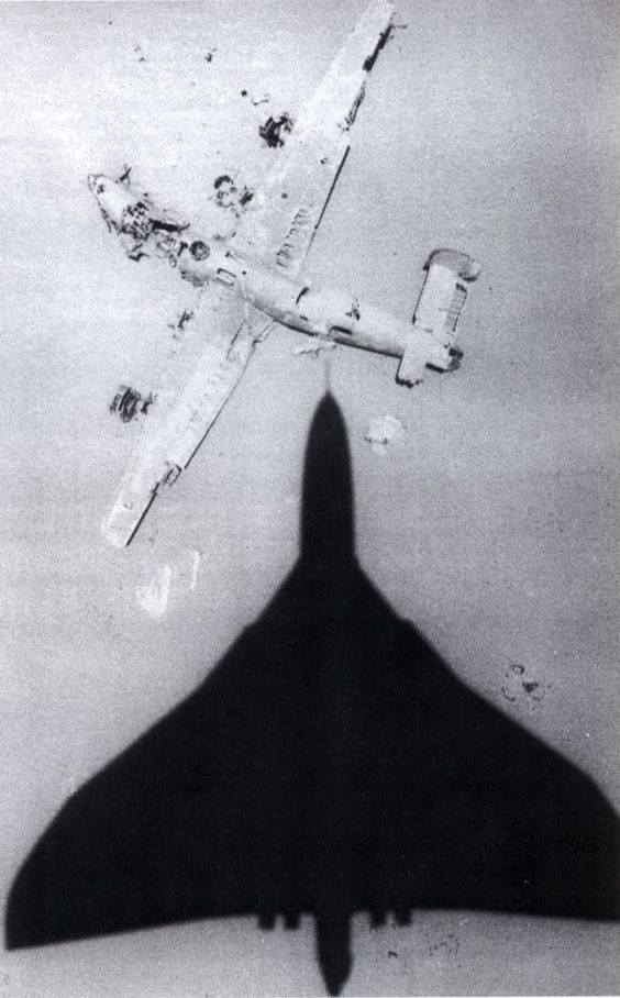 """Avro Vulcan over the wreck of the B-24 """"Lady Be Good"""", Libya, date unknown"""