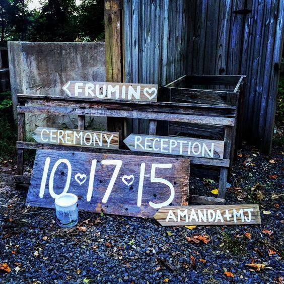 Rustic homemade repurposed wedding directional signs