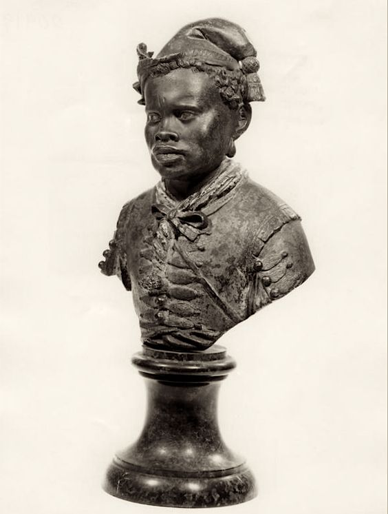 Anonymous Sculptor (Venice)  Portrait Bust of a Man  Italy (early 16th Century)  Polychromed Bronze, 27.9 cm. (H) [Bust of a black man wearing a doublet, a soft cap with a tassle, and earrings.]  Ashmolean Museum of Art and Archaeology, Department of Western Art.: