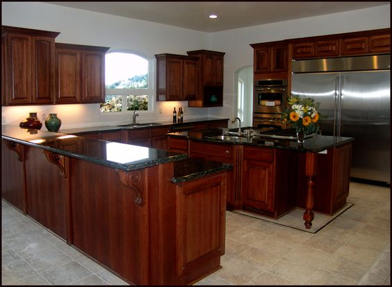 The attractive lyptus cabinetry fits the serenity of this - Kitchen island with cooktop and prep sink ...
