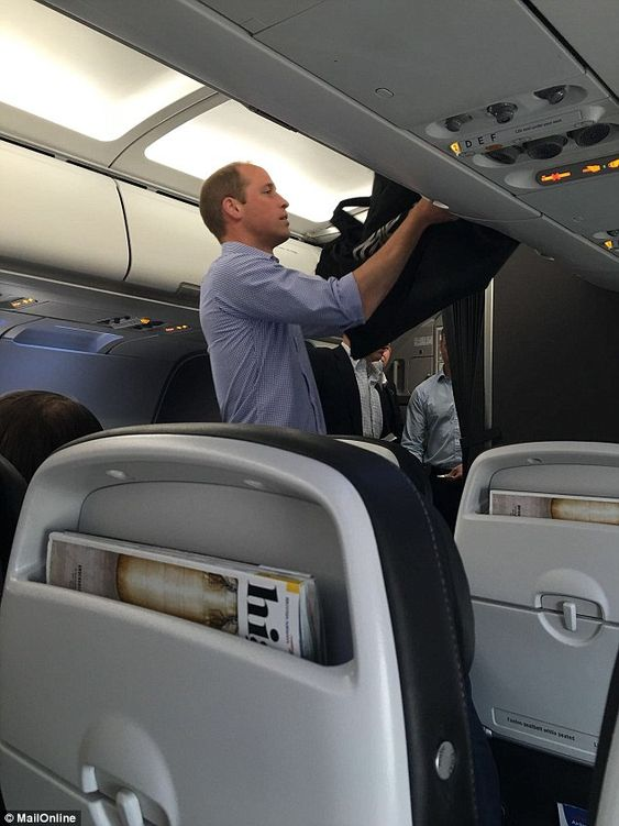 Where's the flunkey? Prince William stows his own bag today as he flies Club World Class back from Lyon to Heathrow on Tuesday morning after England's disappointing match in St Etienne