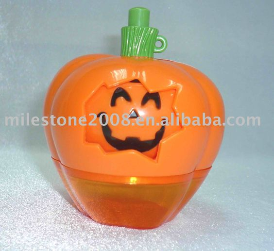 Pumpkin spinner, it is a candy toy but also a Halloween product. Pressing down the stem, the pumpkin face will spin.