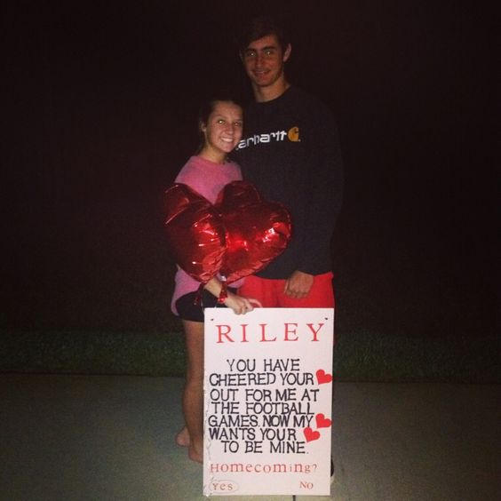Homecoming proposal from football player to cheerleader