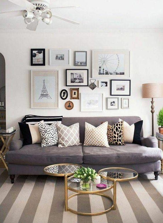 salon gris et blanc, peinture murale blanche, canapé gris, table design intéressant et déco murale magnifique