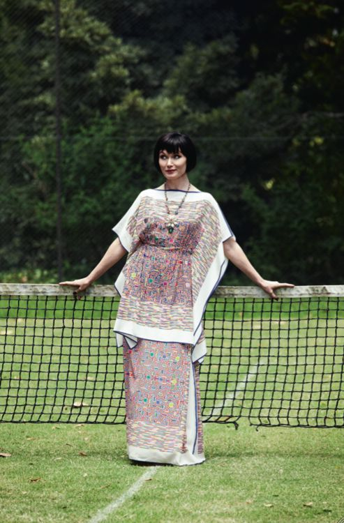 Above, Essie wears a Murray Arbeid tunic and dress. Her necklace is ...