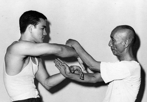 guts-and-uppercuts:  One of the rare pictures of Bruce Lee practicing Wing Chun (Chi Sao) with Ip Man.