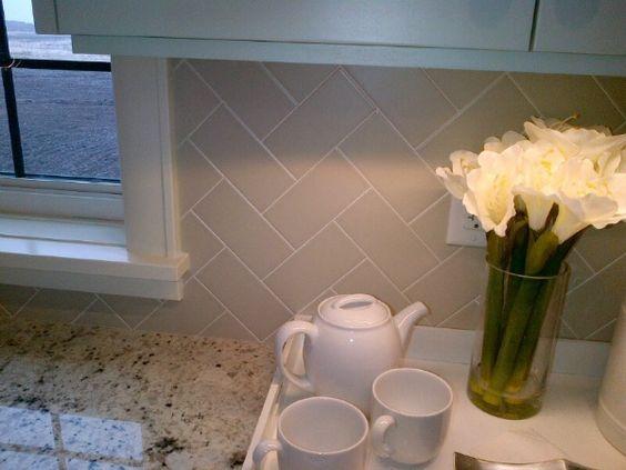 Grey Herringbone Pattern Backsplash in Kitchen Yes! Love this!! I want to do herringbone in my kitchen. :)