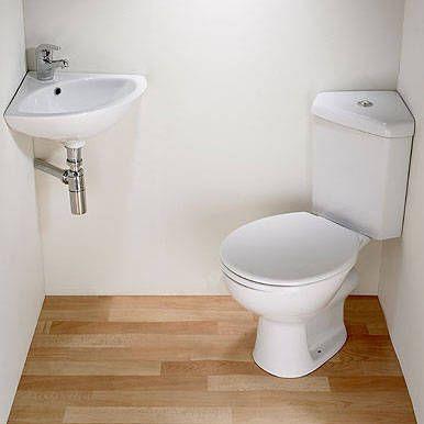 Crazy small bathroom solution corner sink corner toilet for Tiny corner sink