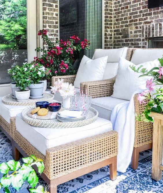Summer patio reveal beautiful chairs ottomans Summer patio reveal beautiful furniture flowering plants #outdoorliving #patio #patiodecor #summerdecor #summerentertaining #outdoordecor