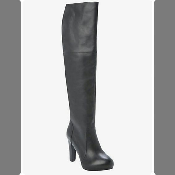 """Knee High Heeled Boots (Wide Width) Black faux leather boots in size 12W by Torrid with a side zipper entry. High heel boot has a top flap that can be folded down or worn tall. Calf size is 19 1/4"""". Rubber stopper on the left boot came off (see last pic) but can be replaced. Overall, these boots are in excellent condition. Torrid  Shoes Heeled Boots"""