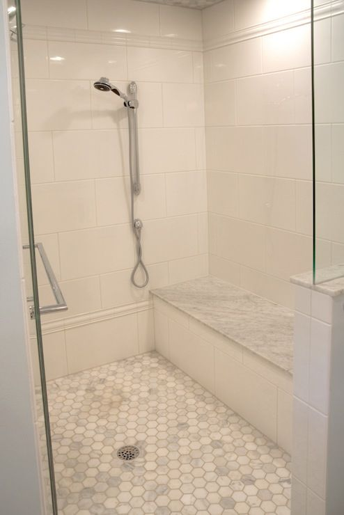 source: Lamantia website  Stunning walk-in shower with oversize white ceramic tile laid in a staggered brick pattern. The shower features a ...