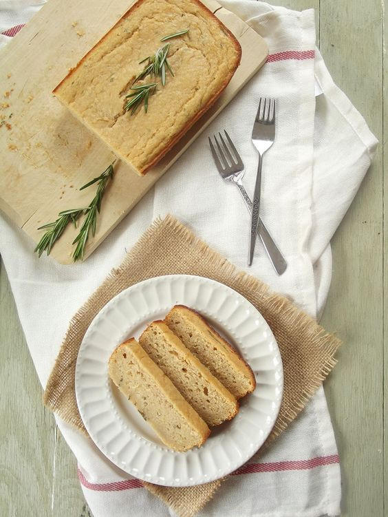 This vegan pound cake is rich, moist, and packed with the flavors of fresh rosemary and lemon. #vegan #recipe by Alissa @ connoisseurusveg.com