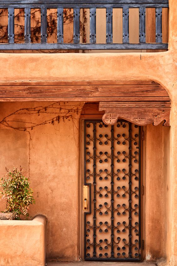 Santa Fe's Historic Adobe Architecture - One characteristic of Santa Fe that makes it stand out among other cities is the same thing that doesn't stand out: its architectural style. The distinctive low-profile adobe buildings are made of earth and sun-dried straw.   http://annemckinnell.com/2012/05/08/santa-fes-historic-adobe-architecture/ #photography #travel #newmexico #blog #architecture: Adobe Door, Beautiful Colors, Architecture Adobe, Beautiful Adobe, Beautiful Doors, Adobe Building, Doors Gates, Adobe Architecture
