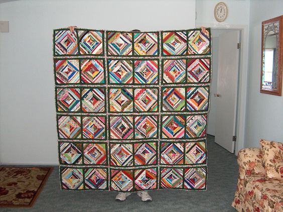 My selvage quilt finished today! Just my style- all kinds of funky colors and using up what some folks toss away.