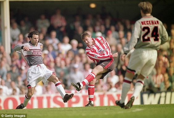 Le Tissier, pictured against Manchester United in 1996, remembers earning £26 a week after signing his first youth contract at Southampton
