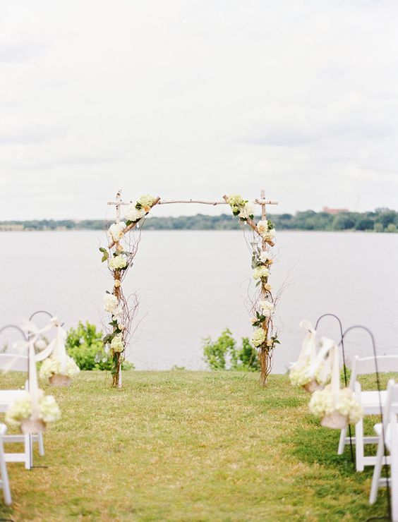 Floral arch at lakeside wedding ceremony at White Rock Lake in Dallas - Photo by Ben Q. Photography