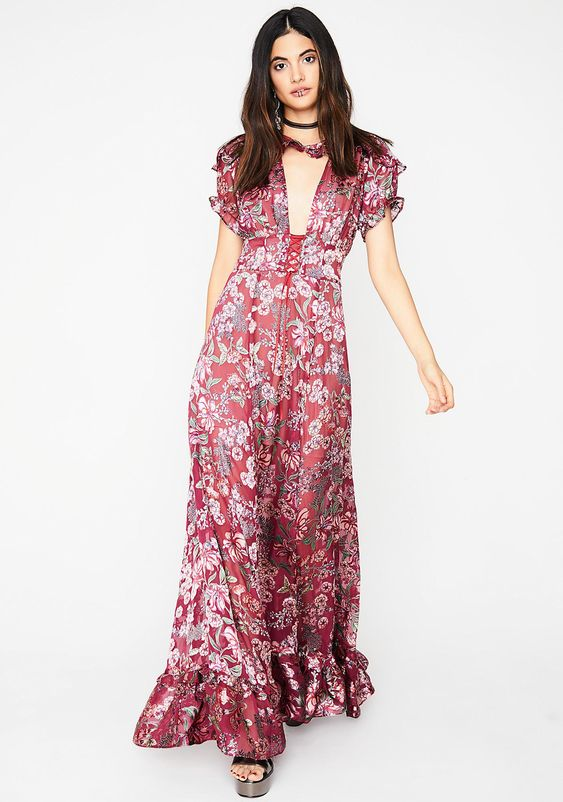 For Love & Lemons Berry Flora Maxi Dress will have ya feelin' like a garden nymph dream babe. This gorgeous floor length dress has soft ruffled trim, a sexi cut-out front detail with a lace-up corset waistline.