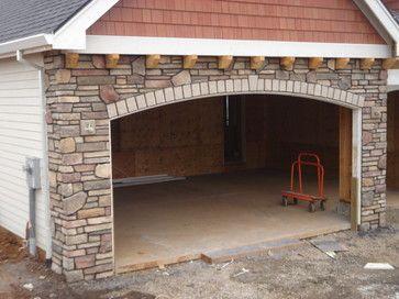 Traditional sheds and stone veneer exterior on pinterest for Wood veneer garage doors