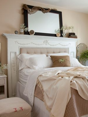 Love, love LOVE the fireplace mantel that forms the framework for the headboard.  I MUST do this. and the curtains.