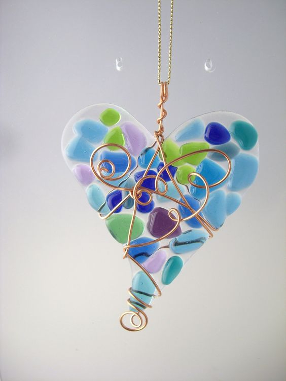Fused glass heart suncatcher in blues, greens & purples.