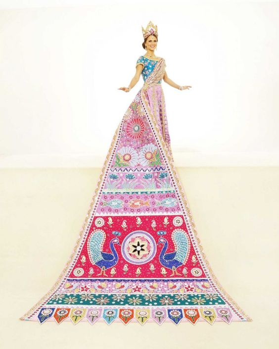 Katherine Basse Farmer, Duchess of Symbolic Artistry: The rich colors and figures of charming Indian folk art are seen on this gown embroidered in gold with pink Austrian stones and violet beading. The train's sun, moon, plants, birds, flowers and fish are adorned with sequins, rhinestones and scalloped gold rope trim. She is the daughter of Mr. and Mrs. Gary Stephen Farmer.