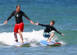 take surfing lessons