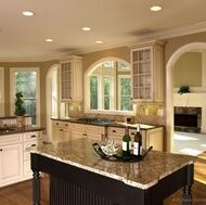 Kitchen designed with Antique White Cabinets and Black Island