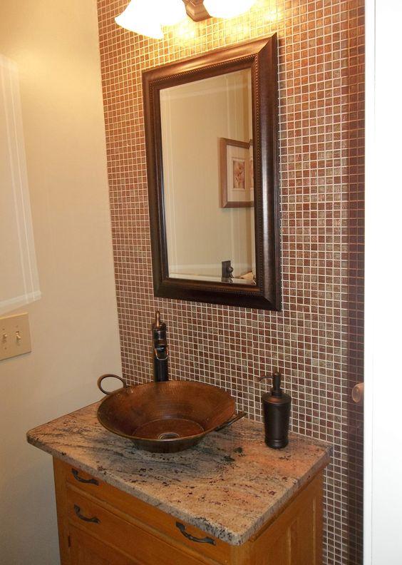 Bathroom remodel using copper glass tiles as backsplash for Redo bathroom sink