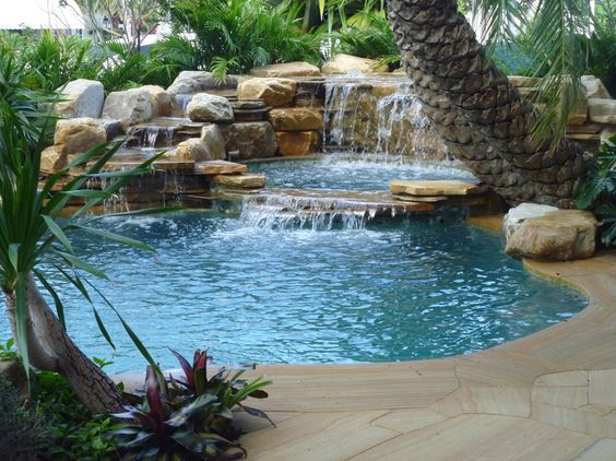 Pools with waterfalls waterfalls into pool jacuzzi for Pool jacuzzi design