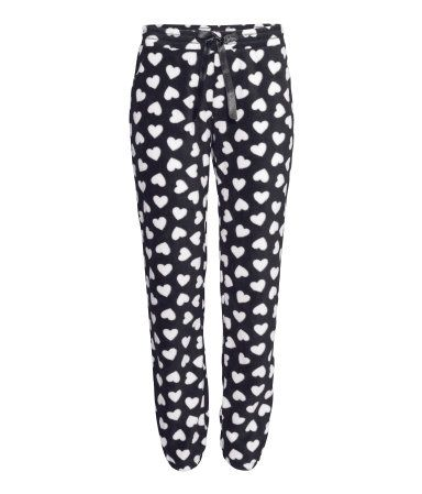 Make someone feel all warm & fuzzy with these comfy black & white heart pajama pants.   H&M Gifts